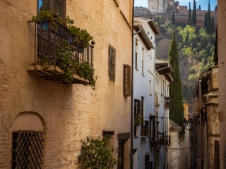 Granada street with view of Alhambra, Andalucia Spain
